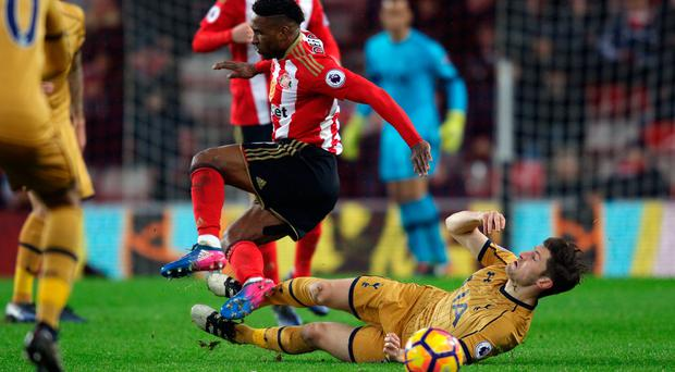 Heat of battle: Spurs' Ben Davies slides in on Jermain Defoe