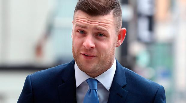 Footballer Anthony Stokes arrives at Dublin's Circuit Criminal Court for a sentencing hearing for assaulting an Elvis impersonator in a nightclub. Niall Carson/PA Wire