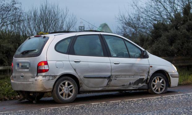 Vehicle with two flat tyres following the use of a stinger. Newraypics.com
