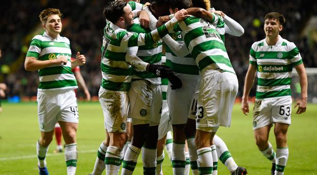 Celtic's Dedryck Boyata celebrates with teammates after scoring his side's first goal of the game during the Ladbrokes Scottish Premiership match at Celtic Park, Glasgow. Ian Rutherford/PA Wire.