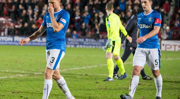 Rangers Clint Hill and Lee Wallace are dejected after the Ladbrokes Scottish Premiership match at Tynecastle Stadium, Edinburgh. Jeff Holmes/PA Wire.