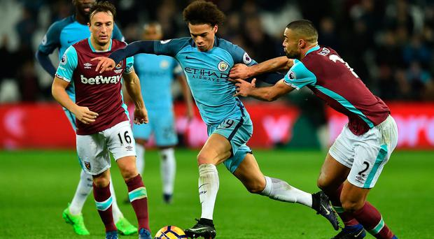 Manchester City's German midfielder Leroy Sane (C) vies with West Ham United's English midfielder Mark Noble (L) and West Ham United's New Zealand defender Winston Reid during the English Premier League football match between West Ham United and Manchester City at The London Stadium, in east London on February 1, 2017. / AFP PHOTO / Glyn KIRK /