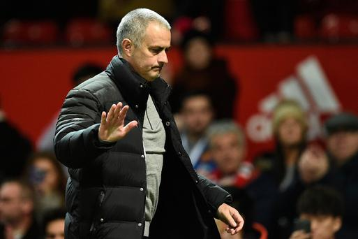 Manchester United's Portuguese manager Jose Mourinho reacts as he leaves following the English Premier League football match between Manchester United and Hull City at Old Trafford in Manchester, north west England, on February 1, 2017. The match ended in a draw at 0-0. / AFP PHOTO / Oli SCARFF /