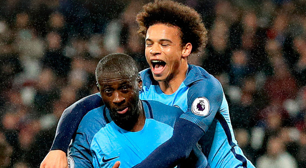 Toure de force: Leroy Sane celebrates with scorer Yaya Toure after his penalty had put the seal on City's emphatic success to complete a miserable evening for West Ham boss Slaven Bilic