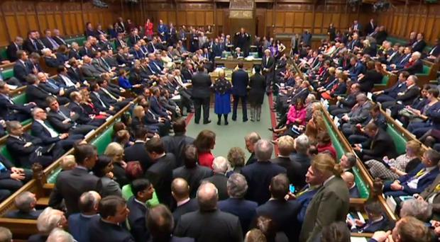 MPs queue up to vote in the Commons at Westminster last night