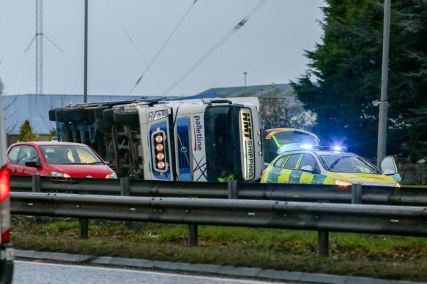 Pictured: An overturned lorry at the Sprucefield roundabout. Picture: Philip Magowan / PressEye
