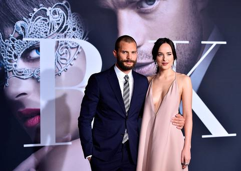 LOS ANGELES, CA - FEBRUARY 02: Actors Jamie Dornan and Dakota Johnson attend the premiere of Universal Pictures'