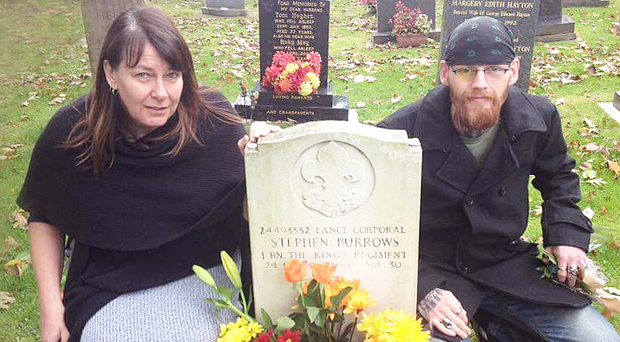 Jane Hunter and son Mark at the grave of her late husband Lance Corporal Stephen Burrows