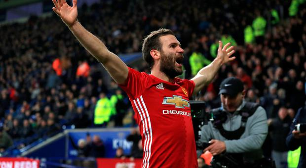 Manchester United's Juan Mata celebrates scoring his side's third goal of the game during the Premier League match at the King Power Stadium, Leicester. Mike Egerton/PA Wire.