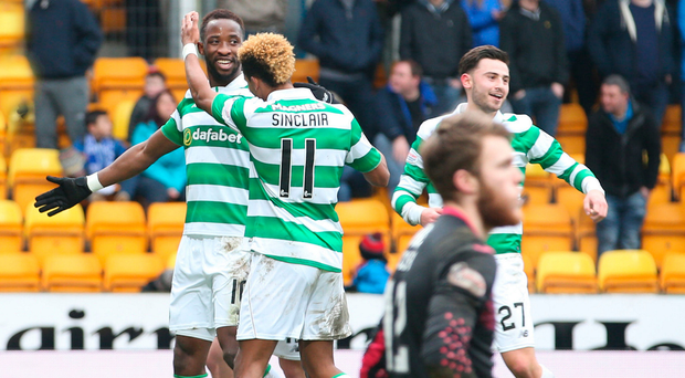 Treble yell: Moussa Dembele celebrates his hat-trick success