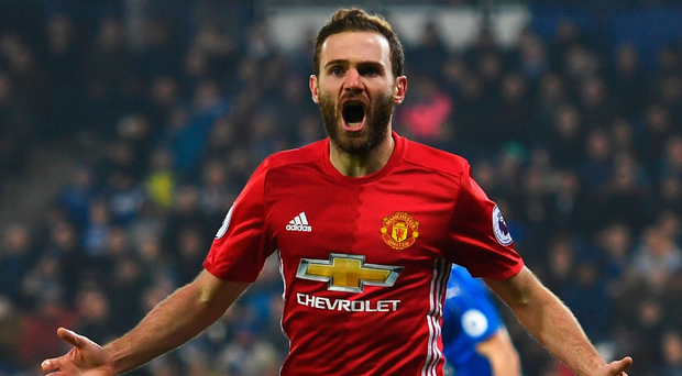 Clincher: Juan Mata wheels away after scoring United's third goal against Leicester