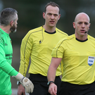 Anger: Armagh goalkeeper John Connolly confronts referee Arnold Hunter