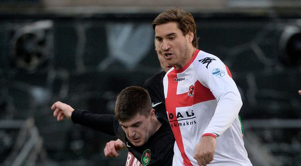 Strength: Crusaders' Mikel Suarez in action with PSNI's Adam Wright