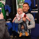Belfast Boxer Carl Frampton with young Jake Kane at a signing session for fans in Victoria Square on Monday evening. Carl was greeted by fans in Belfast after losing for the first time in his professional career against Leo Santa Cruz. Pic Colm Lenaghan/ Pacemaker
