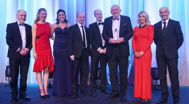A club full of heroes: Slaughtneil, the incredible gaelic club from Derry, won the Local Heroes award at year's night's bash after sweeping all before them in county and Ulster competition during 2016. Receiving the trophy on behalf of the club is Chairman Sean McGuigan (centre).