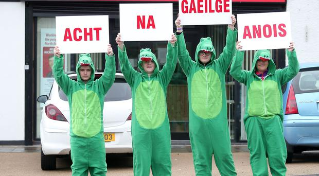 Irish language activists dressed as crocodiles protest outside the DUP's Nelson MCausland's office on the Ballysillan Road in north Belfast. Picture by Jonathan Porter/PressEye.com