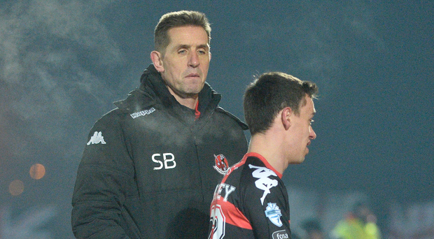 Off night: Stephen Baxter has words of comfort for Heatley