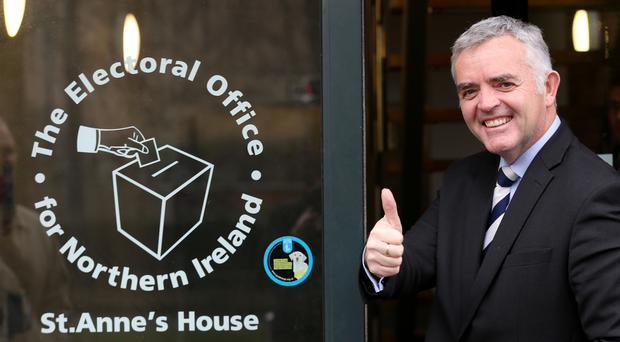 Jonathan Bell arrives at the electoral office