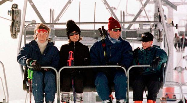 File photo dated 01/01/97 of the Prince of Wales with his younger son Prince Harry, joined in a ski lift by left to right) Santa with her sister, Tara Palmer-Tomkinson, on the way up the Gotschnabahn ski runs above Klosters, Switzerland, as socialite Tara Palmer-Tomkinson, who had been diagnosed with a brain tumour, has been found dead at her home in south west London, sources said. John Stillwell/PA Wire