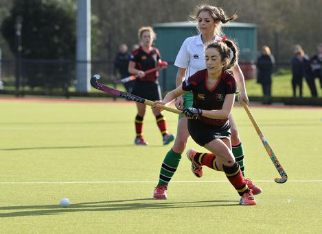 Class act: Katie McKee sets up another Banbridge Academy attack during the semi-final at Lisnagarvey despite the close attention of Sullivan's Ali Gibson