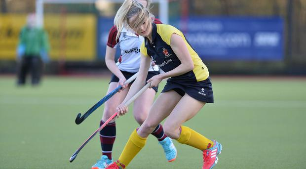 Leading lady: Wallace's Alyssa Jebb sets the Lisburn school off on another attack against Royal School Armagh in the Schools' Cup semi-final