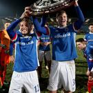 Trophy hunt: Linfield's Cameron Stewart and Kirk Millar lift the County Antrim Shield