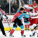 Fighting spirit: Belfast Giants' Adam Keefe takes on Patrick Bordeleau at the SSE Arena last night