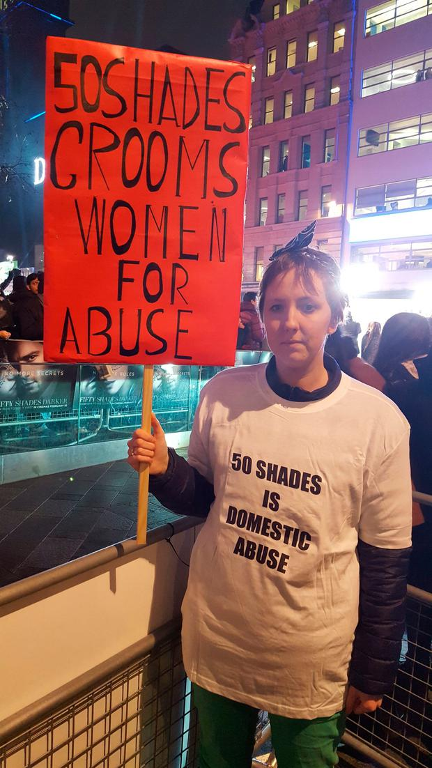 Protesters holding banners during the Fifty Shades Darker European Premiere held at Odeon Leicester Square, London. PA