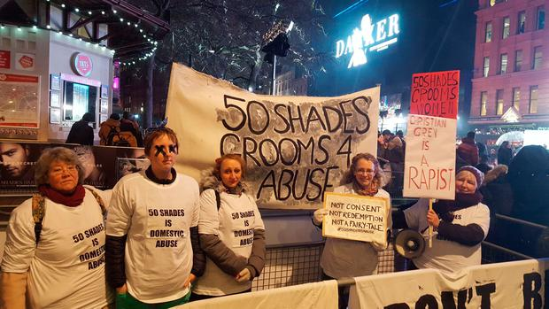 Protestors holding banners during the Fifty Shades Darker European Premiere held at Odeon Leicester Square, London. PA