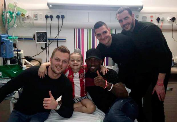 Handout photo taken with permission from the Facebook page of Bradley Lowery Fight Against Neuroblastoma, of Bradley Lowery, 5, a brave football mascot with terminal cancer being visited in hospital by Sunderland football players (left to right) Seb Larsson, Jermain Defoe, Vito Mannone and John O'Shea. PA