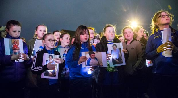 The residents and children of the Short Strand hold a five minute vigil for Conan Anderson