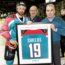 Milestone: Robert Fitzpatrick and Eric Porter congratulate Colin Shields on his 500th appearance for Belfast Giants