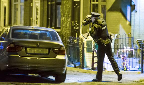 Police attend the scene of a security alert in the Stanfield Place area of Belfast on Thursday night