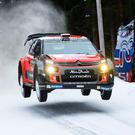 Slippery stuff: Kris Meeke lost vital seconds after the loss of studs from his Citroen's tyres in the icy conditions