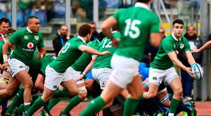 Ireland's Conor Murray (R) catches the ball during the team's Six Nations rugby union match Italy against Ireland at the Olympic Stadium in Rome on February 11, 2017. / AFP PHOTO / Vincenzo PINTOVINCENZO PINTO/AFP/Getty Images