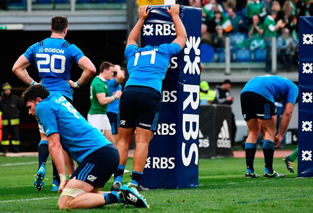 Italian players react after Ireland's Craig Gilroy scored a try during the team's Six Nations rugby union match between Italy and Ireland at the Olympic Stadium in Rome on February 11, 2017. / AFP PHOTO / Vincenzo PINTOVINCENZO PINTO/AFP/Getty Images