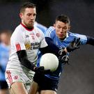 Close call: Tyrone's Niall Sludden and Dublin's John Small