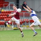 Kicking on: Slaughtneil's Patsy Bradley looks to set up an attack against St Vincent's in Pairc Esle