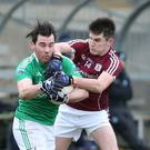 Tight tussle: Barry Mulrone of Fermanagh and Barry McHugh