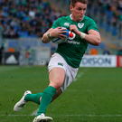 Fine form: Ireland's Craig Gilroy on his way to scoring a try
