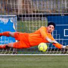 Foiled: Daniel Hughes' penalty is stopped by Richard Brush