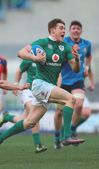 Running man: Ireland's Garry Ringrose on his way to scoring a try against the Italians in Rome