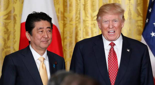 President Donald Trump and Japanese Prime Minister Shinzo Abe (left). (AP Photo/Pablo Martinez Monsivais)