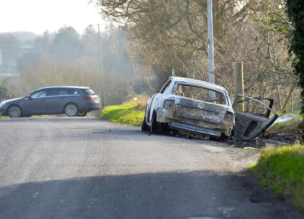 Police are investigating a possible link to a silver Skoda car which was in the Carrigart area before the shooting in Craigavon. It was found burnt out in the New Line area of Lurgan. Photo Colm Lenaghan/Pacemaker Press