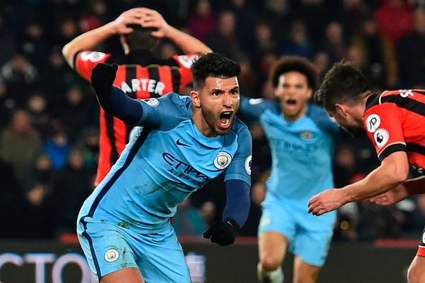 Manchester City's Argentinian striker Sergio Aguero celebrates after scoring their second goal during the English Premier League football match between Bournemouth and Manchester City at the Vitality Stadium in Bournemouth, southern England on February 13, 2017. AFP/Getty Images