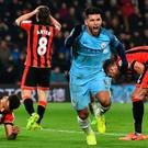 Over the line: Sergio Aguero turns away to celebrate Tyrone Mings' own goal