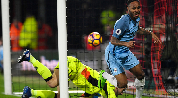 Pick it out: Raheem Sterling after opening the scoring for Manchester City at Bournemouth