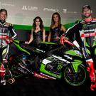 Wheeled out: Jonathan Rea with team-mate Tom Sykes and their 2017 bikes at the Kawasaki Racing Team launch in Barcelona