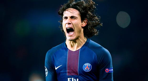 PSG's Edinson Cavani celebrates scoring his team's fourth goal of the game during the Champions League round of 16, first leg soccer match between Paris Saint Germain and Barcelona at the Parc des Princes stadium in Paris, Tuesday, Feb. 14, 2017. (AP Photo/Francois Mori)