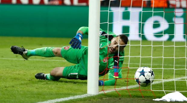 Arsenal's Colombian goalkeeper David Ospina misses a goal by Bayern Munich's Polish forward Robert Lewandowski during the UEFA Champions League round of sixteen football match between FC Bayern Munich and Arsenal in Munich, southern Germany, on February 15, 2017. / AFP PHOTO / Odd ANDERSENODD ANDERSEN/AFP/Getty Images